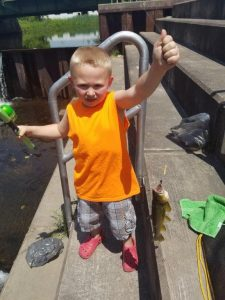 Zyla's son, Xander, 6, shows off the fish he caught. (provided by Alan Zyla)