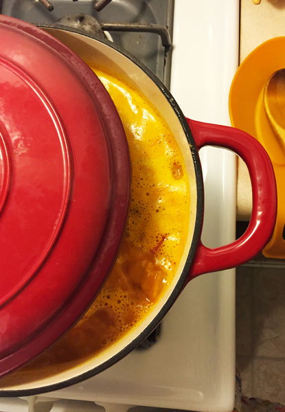 A delicious stew made with turmeric simmering on the stove.