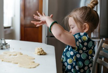 A child playing with cookie dough