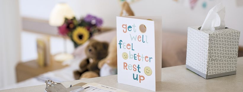 Picture of a get well soon card in a hospital room.