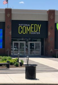 Picture of the front of a building that is the National Comedy Center