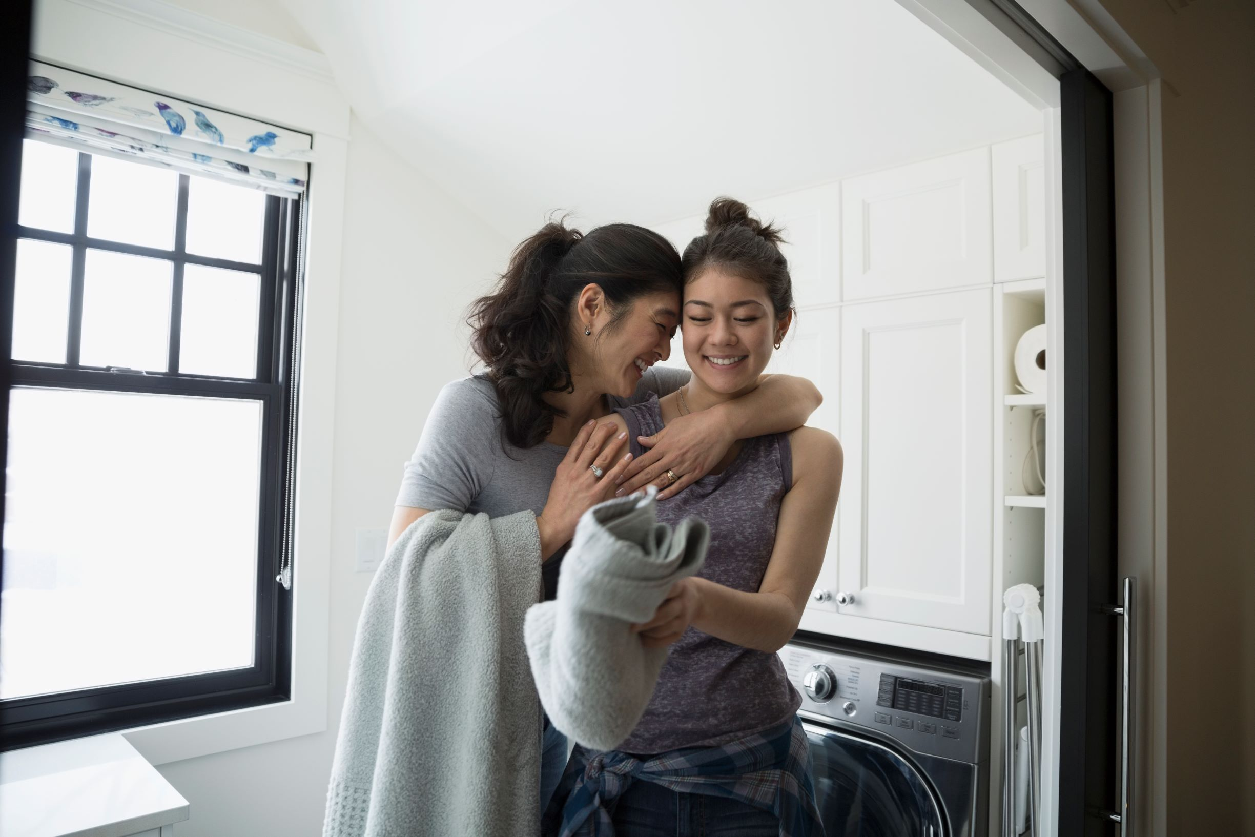 Picture of mom hugging a daughter