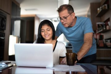Picture of a dad helping child with homework
