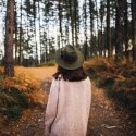 Picture of a woman walking alone in the woods