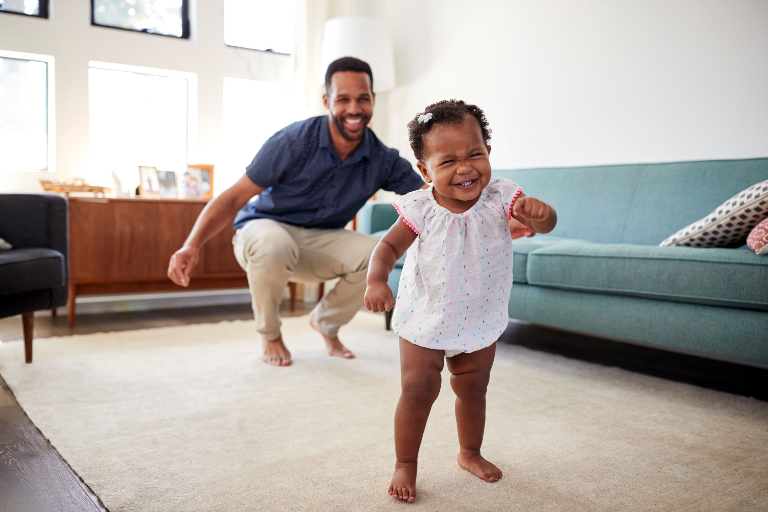Picture of a dad and baby girl dancing