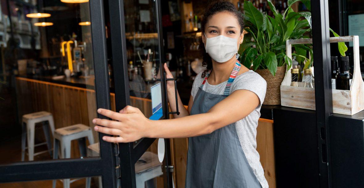 Picture of woman in mask opening door