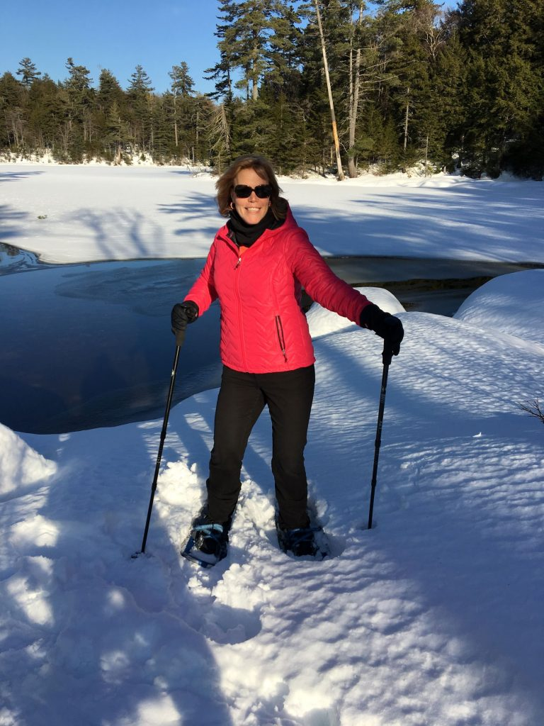 Picture of a woman snowshowing